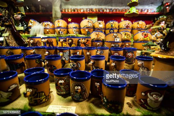 A stand with cups with funny colored animals on it Christmas Market in Erlangen Bavaria Germany