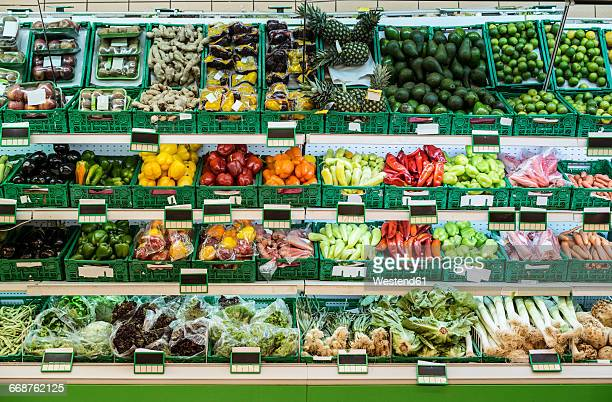 stand with fruits and vegetables in the supermarket - freshness fotografías e imágenes de stock