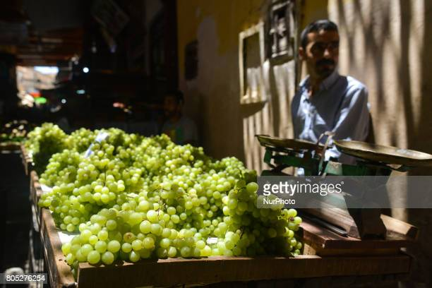 A stand with grapes in display for sale inside Fes medina On Saturday July 1 in Fes Morocco