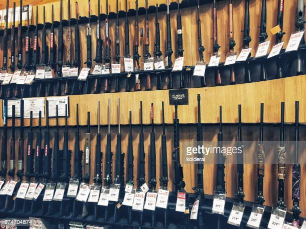 stand with shotguns for sale in usa - armi foto e immagini stock