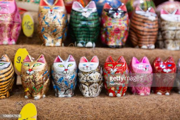 Stand with small colorful cats The Christmas Market at the Chinesischer Turm in the Englischer Garten is opened until the 24th of December
