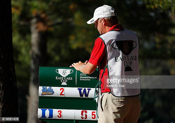A standard bearer is seen on the 17th hole during day 1 of the 2016 East Lake Cup at East Lake Golf Club on October 31 2016 in Atlanta Georgia