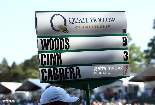 A standard bearer walks off the 18th green after Tiger Woods shot a sevenover par 79 during the second round of the 2010 Quail Hollow Championship at...