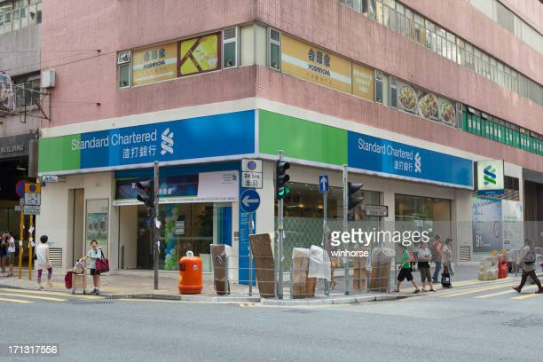 standard chartered bank in hong kong - standard chartered bank stock pictures, royalty-free photos & images
