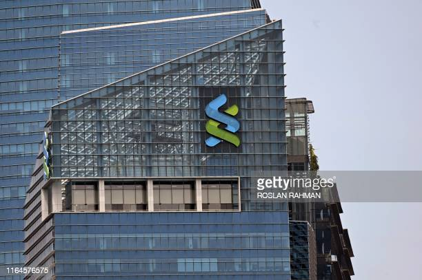 A Standard Chartered Bank logo is displayed on a building in Singapore on August 29 2019