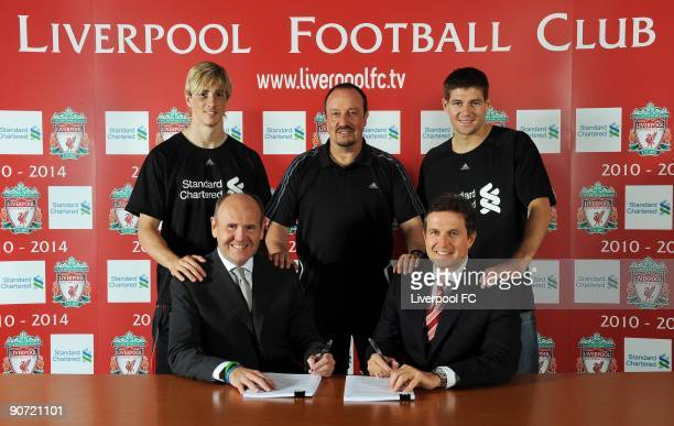 Standard Chartered chairman John Peace and Managing Director Christian Purslow of Liverpool FC sign the new four year sponsorship deal as Fernando...