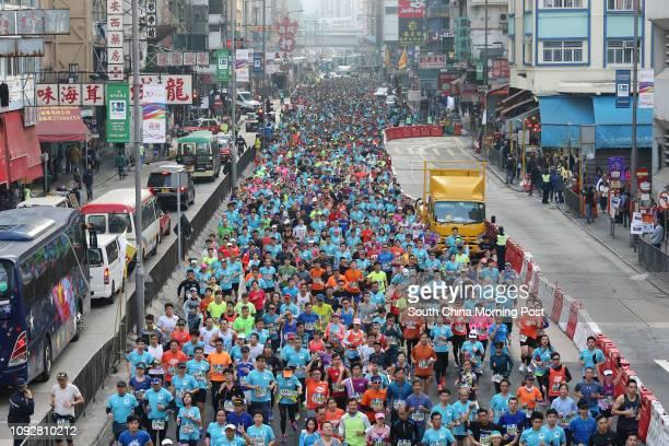 Standard Chartered Hong Kong Marathon runners passing through Mong Kok 12FEB17 SCMP/ Dickson Lee