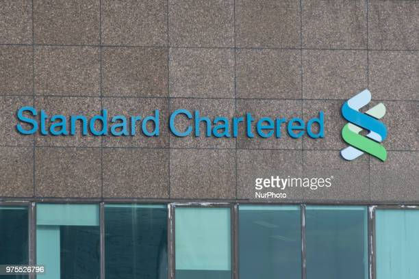 Standard Chartered logo can be seen at its office in Singapore on June 12 2018