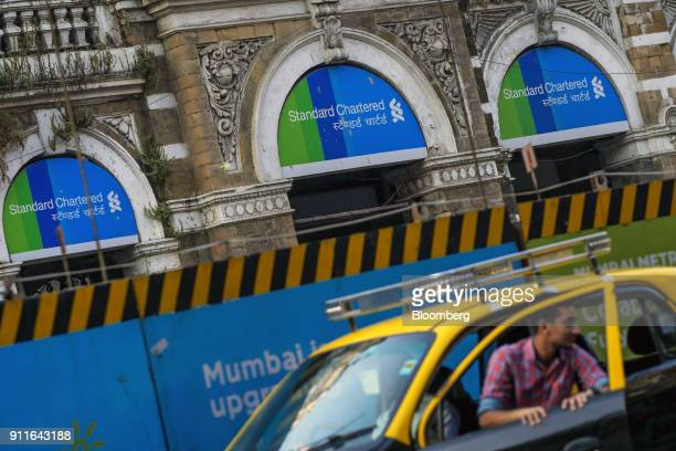 A Standard Chartered Plc bank branch stands in Mumbai India on Saturday Jan 27 2018 India's economy is expected to grow at 675 percent this year on...