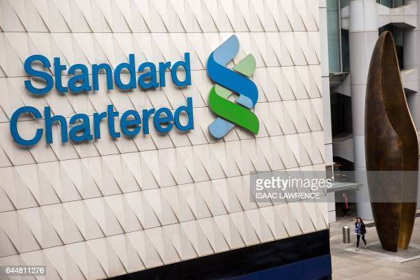 A Standard Chartered sign is seen in the Central district of Hong Kong on February 24 2017 Asiafocused bank Standard Chartered on February 24...