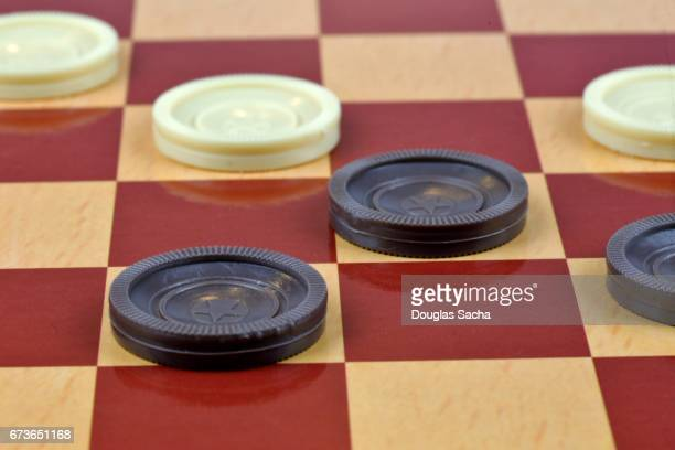 standard checker board with game used tokens - chequers stock photos and pictures