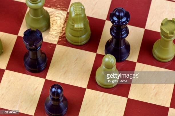 standard chess board with game used tokens - chequers stock photos and pictures