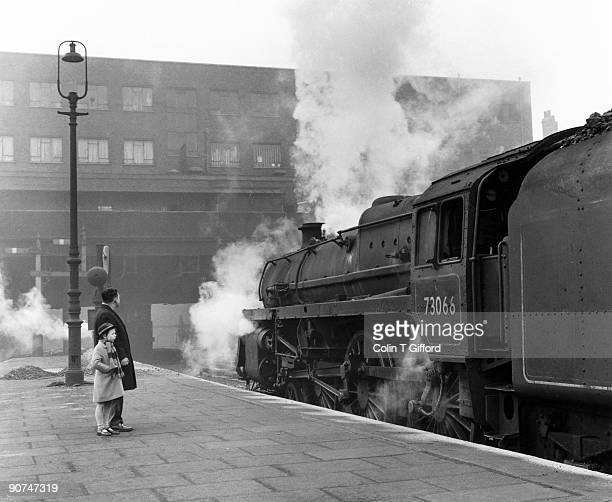 Standard class 5 4-6-0 Number 73066 steam locomotive pulling an express train bound for Marylebone Station in London leaving Victoria Station in...