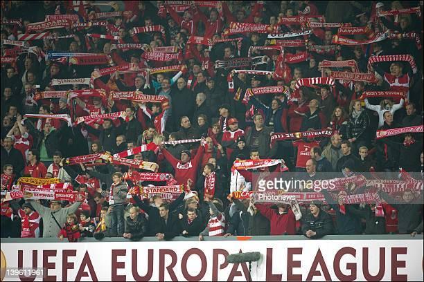 Standard de Liege fans celebrate their win over Wisla Krakow during their Europa League match on February 23 2012 in Liege Belgium