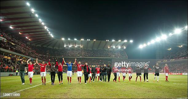 Standard de Liege players celebrate their win over Wisla Krakow in their Europa League match on February 23 2012 in Liege Belgium