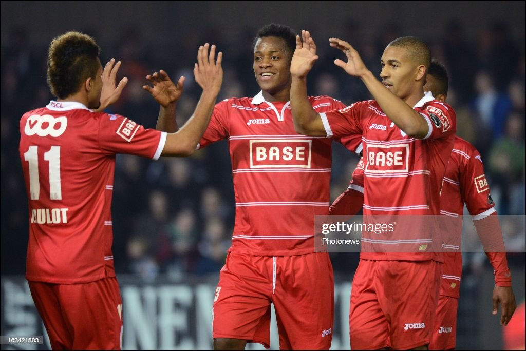 Standard de Liege's Michy Batshuayi, (C) celebrates with team-mates after scoring during the Jupiler Pro League match between OH Leuven and Standard de Liege on March 9 in Leuven, Belgium.