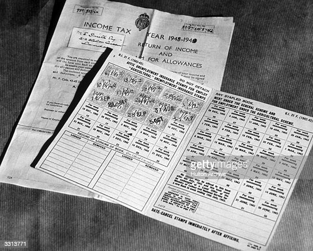 A standard Income Tax return form and an unemployment Insurance card