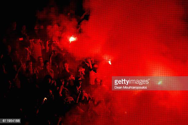 Standard Liege fans let off flares prior to kickoff during the UEFA Europa League group G match between AFC Ajax and R Standard de Liege at the...