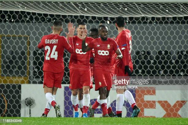 Standard Liege's Belgian forward Maxime Lestienne celebrates with teammates after scoring a goal during the UEFA Europa League Group F football match...