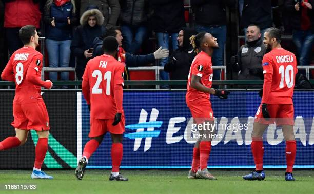 Standard Liege's Belgian midfielder Samuel Bastien celebrates with teammates after scoring during the UEFA Europa League Group F football match...