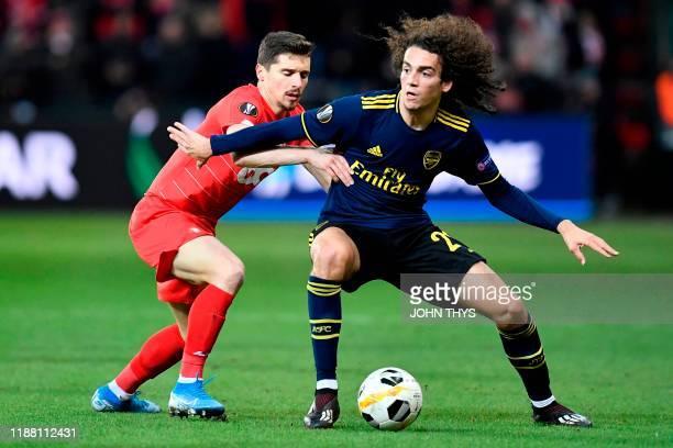 Standard Liege's Bosnian midfielder Gojko Cimirot vies with Arsenal's French midfielder Matteo Guendouzi during the UEFA Europa League Group F...