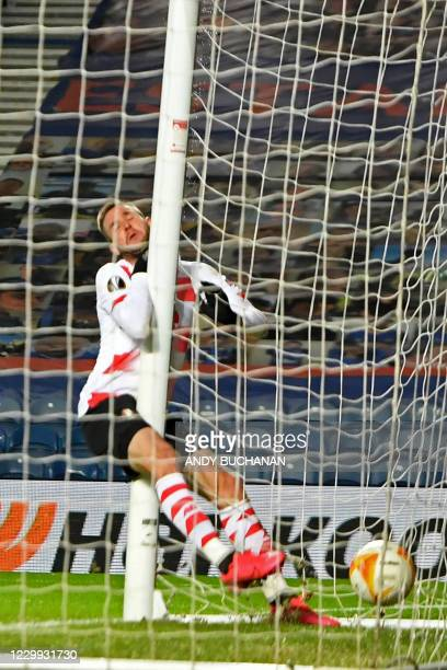 Standard Liege's Croatian forward Duje Cop collides with the post after scoring their second goal during the UEFA Europa League 1st round Group D...
