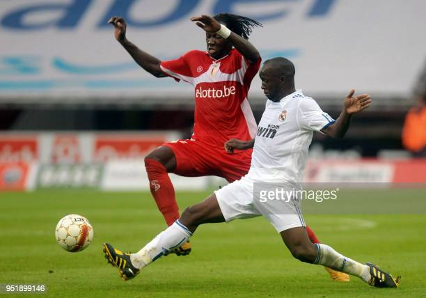Standard Liege's Eliaquim Mangala and Real Madrid's Lassana Diarra fight for the ball during their friendly football Standard versus Real Madrid at...