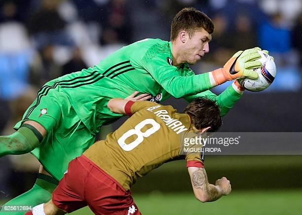 Standard Liege's forward Benito Raman collides with Celta Vigo's goalkeeper Ruben Blanco during the Europa League Group G football match RC Celta de...
