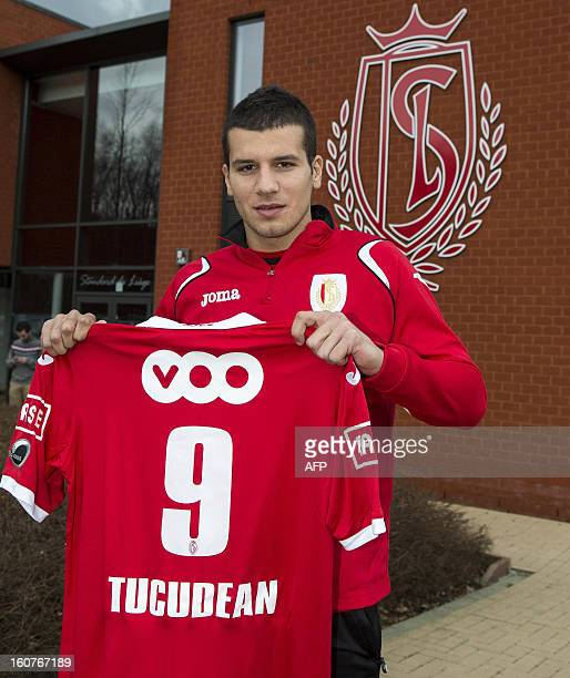 Standard Liege's new player Georges Tucudean poses with his jersey after a press conference at the Belgian first division football team's staduim on...