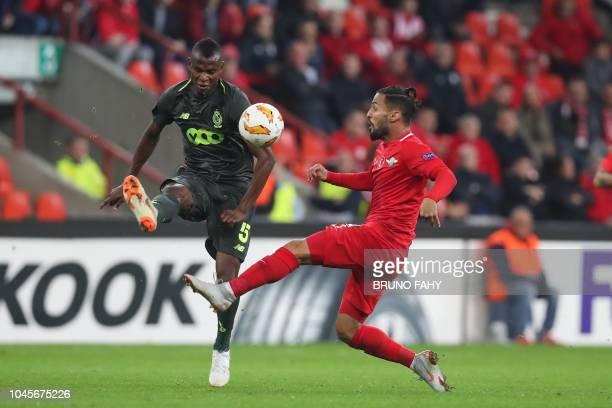 Standard Liege's Nigerian midfielder Uche Agbo vies with Akhisar's Portuguese midfielder Helder Barbosa during their UEFA Europa League Group J...