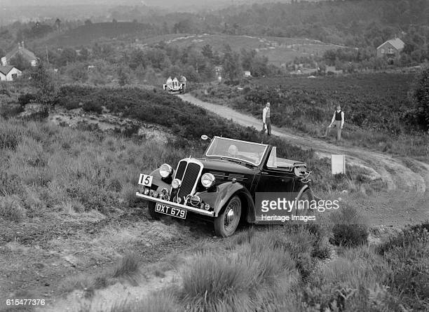 Standard Twelve open 4seater taking part in the NWLMC Lawrence Cup Trial 1937 Standard 12 Open 4 seater 1937 1608 cc Vehicle Reg No DXT679 Event...