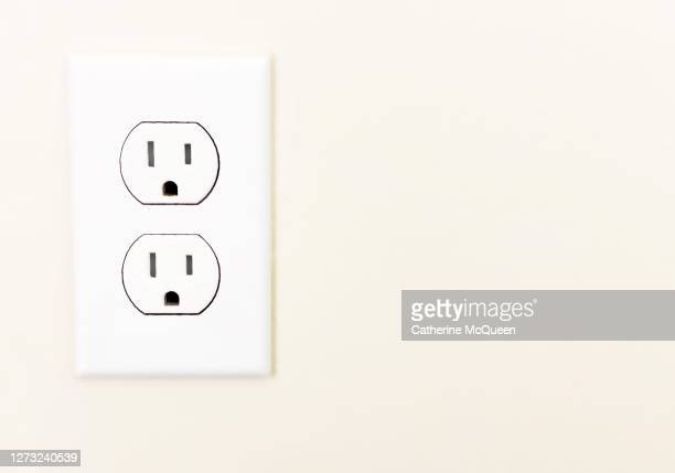standard voltage u.s. electrical outlet - electrical outlet stock pictures, royalty-free photos & images