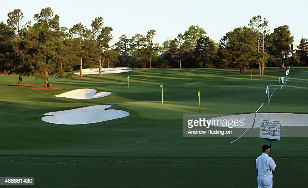 A standardbearer is pictured surveying the practice area during the Drive Chip and Putt Championship at Augusta National Golf Club on April 5 2015 in...