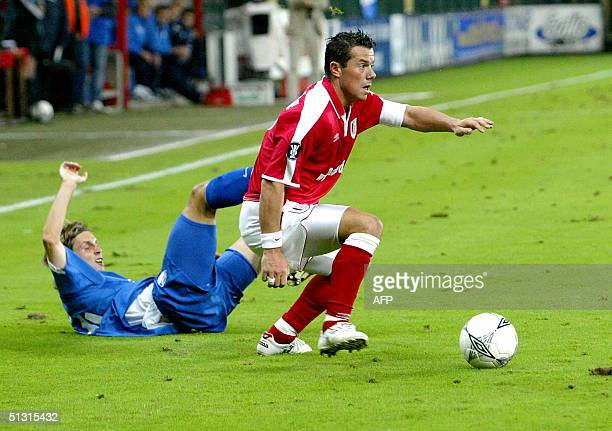 Standard's Eric Deflandre chases Bochum's Philipp Boenig during a UEFA Cup qualifying match Standard Liege vs Bochum 16 September 2004 in Liege...