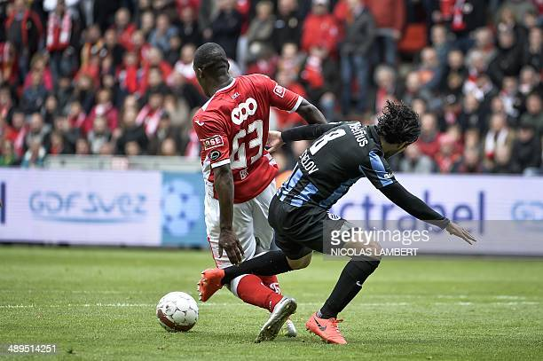 Standard's Geoffrey Mujangi Bia vies with Club's Lior Refaelov during the Jupiler Pro League match of PlayOff 1 between Standard de Liege and Club...
