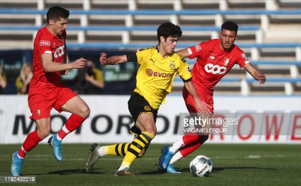 Standard's Gojko Cimirot and Dortmund's Giovanni Reyna fight for the ball during a friendly soccer game between Belgian team Standard de Liege and...