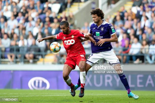 Standard's Mehdi Carcela and Anderlecht's Philippe Sandler fight for the ball during a soccer match between RSC Anderlecht and Standard de Liege,...