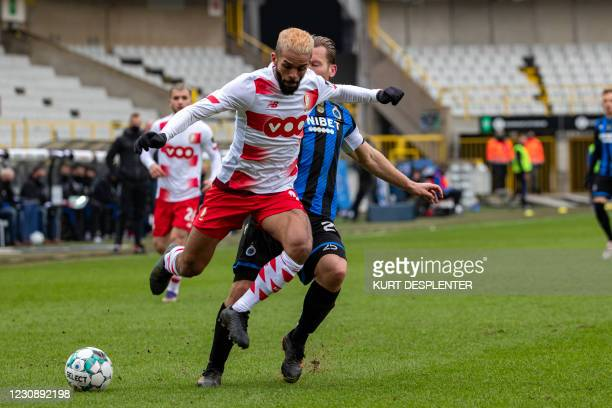 Standard's Mehdi Carcela and Club's Ruud Vormer fight for the ball during a soccer match between Club Brugge and Standard de Liege, Sunday 31 January...