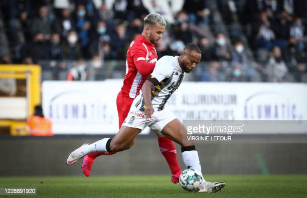 Standard's Nicolas Raskin and Charleroi's Marco Ilaimaharitra fight for the ball during a soccer match between Sporting Charleroi and Standard de...