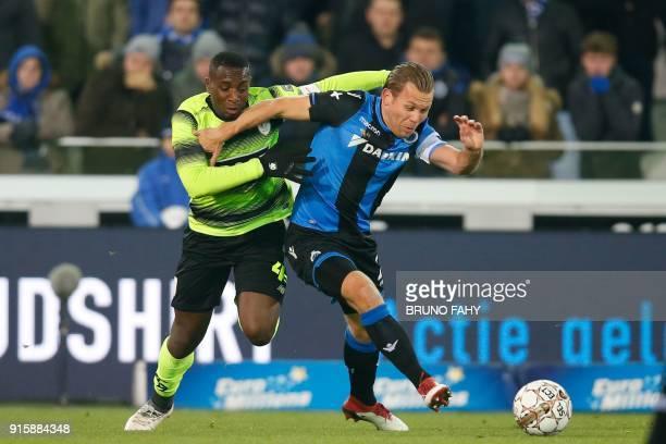 Standard's PaulJose M'Poku Ebunge and Club's Ruud Vormer vie during a between Club Brugge KV and Standard de Liege football match the return leg of...