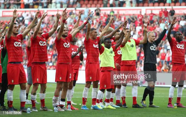 Standard's players celebrate after winning a soccer match between Standard de Liege and KV Kortrijk Sunday 25 August 2019 in Liege on day five of the...