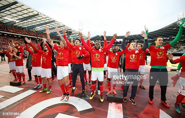 Standard's players jubilate at the end of the Croky Cup football final between Club Brugge and Standard de Liege on March 20 in Brussels / AFP /...