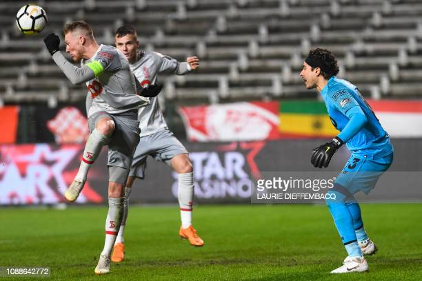 Standard's Renaud Emond and Standard's goalkeeper Guillermo Ochoa pictured in action during a soccer match between Royal Antwerp FC and Standard de...
