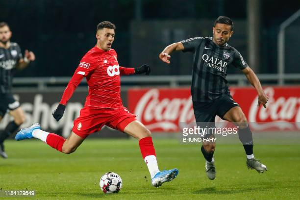 Standard's Selim Amallah and Eupen's Zarandini Ebrahimi fight for the ball during a soccer match between KAS Eupen and Standard de Liege Saturday 23...