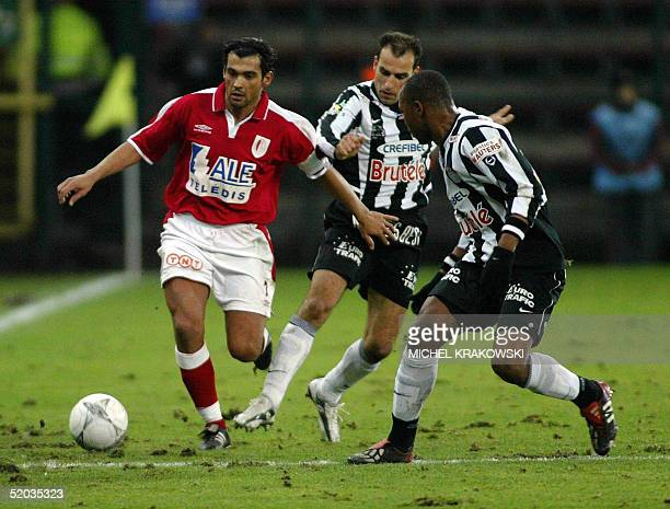Standard's Sergio Conceicao chases Charleroi's Toni Brogno and Ibrahim Kargbo during their 1/8 final match of the Belgium's Football Cup Standard vs...