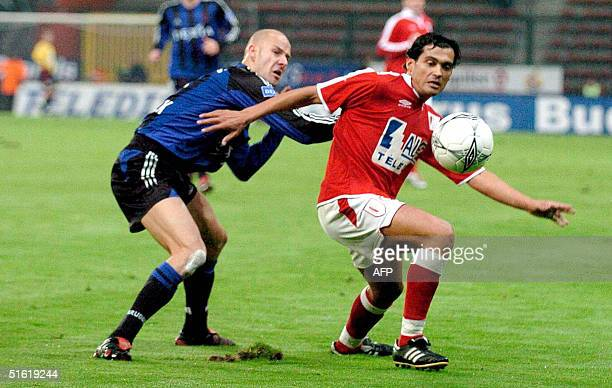 Standard's Sergio Conceicao is chased by Brugge's Olivier De Cock during the first league soccer match Standard vs Club Brugge, 29 October 2004, in...