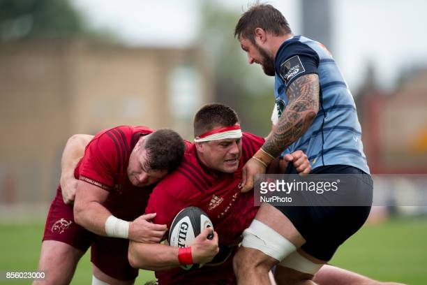 CJ Stander and Dave Kilcoyne of Munster in action with Josh Turnbull of Cardiff during the Guinness PRO14 Conference A Round 5 match between Munster...
