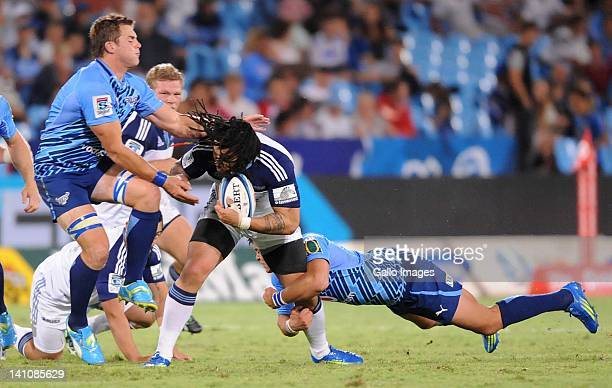 Stander and Francois Venter of the Bulls tackle Ma'a Nonu of the Blues during the 2012 Super Rugby match between Vodacom Bulls and Blues from Loftus...