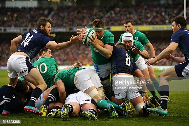 Stander of Ireland dives over a maul to score his team's opening try during the RBS Six Nations match between Ireland and Scotland at the Aviva...