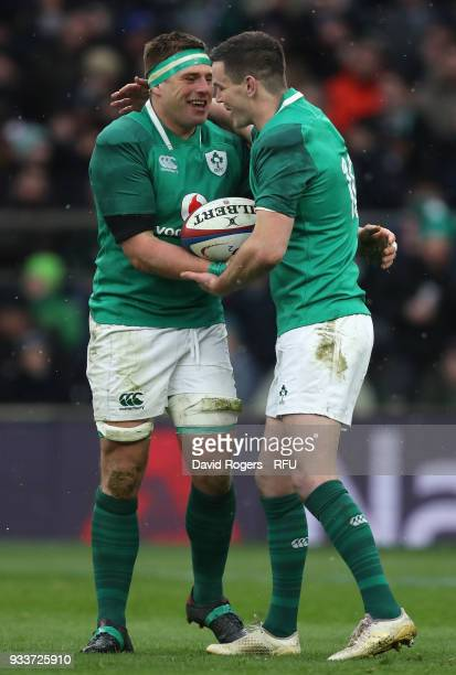 Stander of Ireland is congratulated by team mate Jonathan Sexton after scoring a try during the NatWest Six Nations match between England and Ireland...
